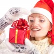 Happy woman in christmas hat with gift - Stock Photo