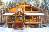 Christmas wooden mansion at pine forest — Stock Photo