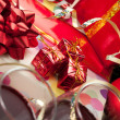 Stock Photo: Holiday gifts and wine glasses