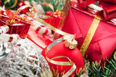 Holiday ornaments and gifts — Stock Photo