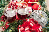 Holiday gifts and wine glasses — Stock Photo