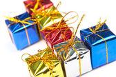 De giften van kerstmis voor veel kleine — Stockfoto