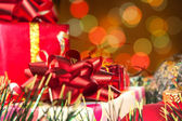 Holiday gifts and blurred lights — Stock Photo