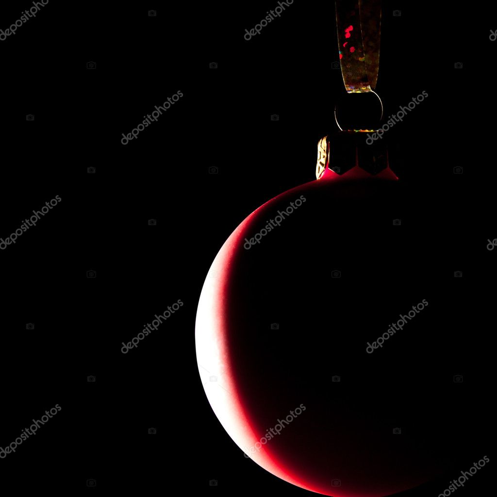 Hanging Christmas red baubles. Isolated on black — Stock Photo #4222762