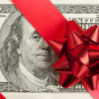 One hundred bill with red bow and ribbon — Stock Photo #4249403