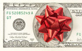One hundred bill with red bow — Stock Photo