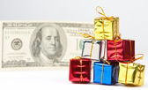 Small Christmas gifts with money — Stock Photo