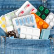 Medicines in jeans pocket — Stock Photo