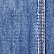 Blue jeans background with seam — Stock Photo
