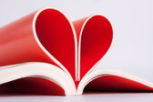 Book pages folded into a heart shape — Stock Photo