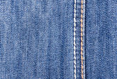 Blue jeans background with seam — Foto Stock