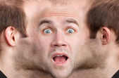 Panoramic face of frightened man — Stock Photo