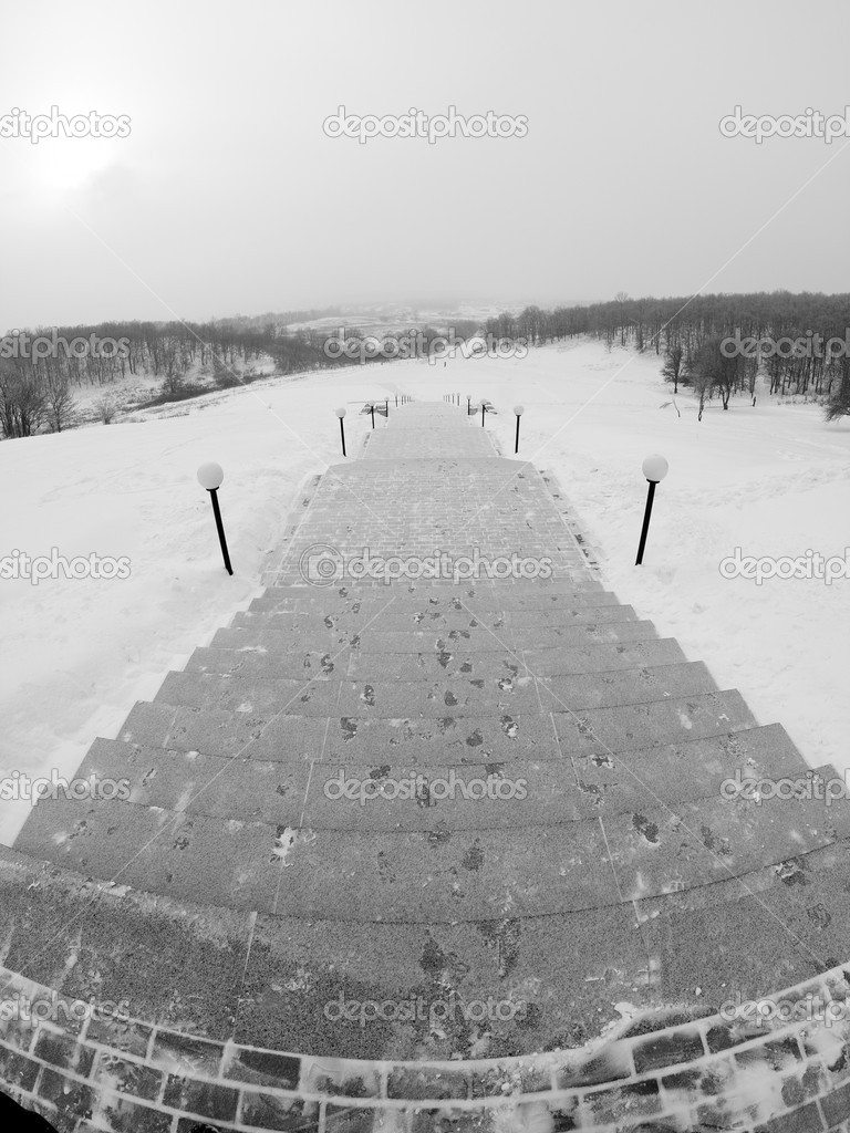 Long steps way down to valley at winter day — Stock Photo #4817490