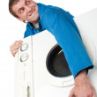 Ominous thief holding stolen washing machine — Stock Photo #4886260