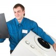 Repairman servicing washing machine — Stock Photo #4886279