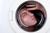 Bizarre man inside washing machine — Stock Photo