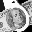 One hundred dollar banknote in handcuffs — Stock Photo #4928522