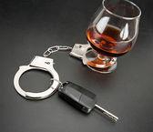 Car key locked to glass of alcohol — Stock Photo
