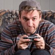 Man with joystick playing video games — Stock Photo #4994932