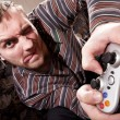 Man with joystick playing video games — Stock Photo #4994942