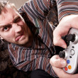 Stock Photo: Man with joystick playing video games
