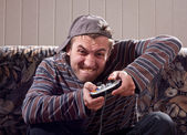 Man with joystick playing video games — Stockfoto