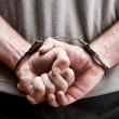 Criminal in handcuffs — Stock Photo