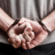 Criminal in handcuffs - Foto Stock