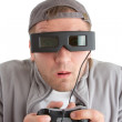 Surprised player with joystick and 3-D glasses — Stock Photo