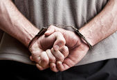 Criminal in handcuffs — Photo