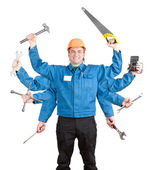 Smiling worker with tools in many hands — Stock Photo