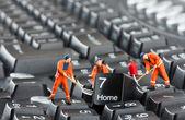 Workers repairing keyboard — Stok fotoğraf