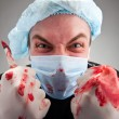 Mad sick surgeon — Stock Photo