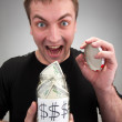 Happy man with canned money — Stock Photo