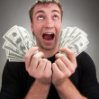 Stock Photo: Very excited man with money