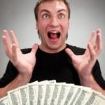 çok heyecanlı adam para ile — Stok fotoğraf