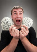 Very excited man with money — Stock Photo