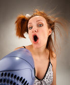Housewife singing with hair dryer — Stock Photo