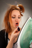 Housewife using lipstick — Stock Photo