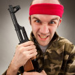Crazy soldier with machine gun — Stock Photo