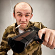 Stock Photo: Impudent bandit with gun