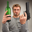 Bizarre sailor choosing between bottle and gun — Stock Photo #5226931