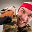 Crazy soldier with machine gun — Stock Photo #5226932