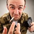 Impudent bandit with gun — Stock Photo