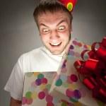 Birthday man opening gift box — Stock Photo #5226986
