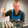 Mad IT worker - Stock Photo