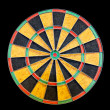 Dartboard isolated on black — Stock Photo