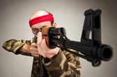 Aiming funny soldier — Stock Photo