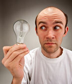 Man holding electrical bulb — Stock Photo