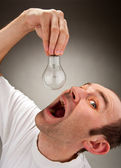 Man eating bulb — Stock Photo